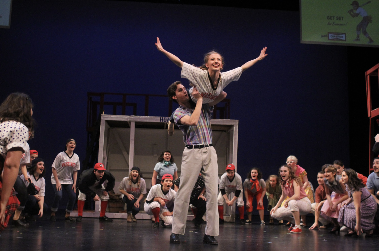 Gabe Kemper and Anna Anderson, seniors, performing a lift in Damn Yankees. One Acts take place in the near future.