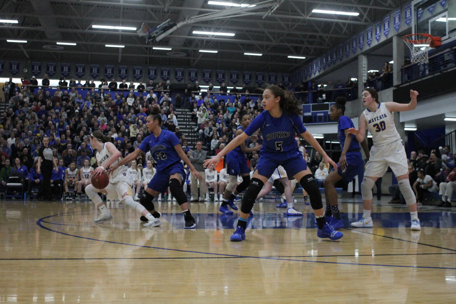 Amaya Battle, freshman, looks on as the Royals play defense. Battle and the Royals take on Lakeville tomorrow night.