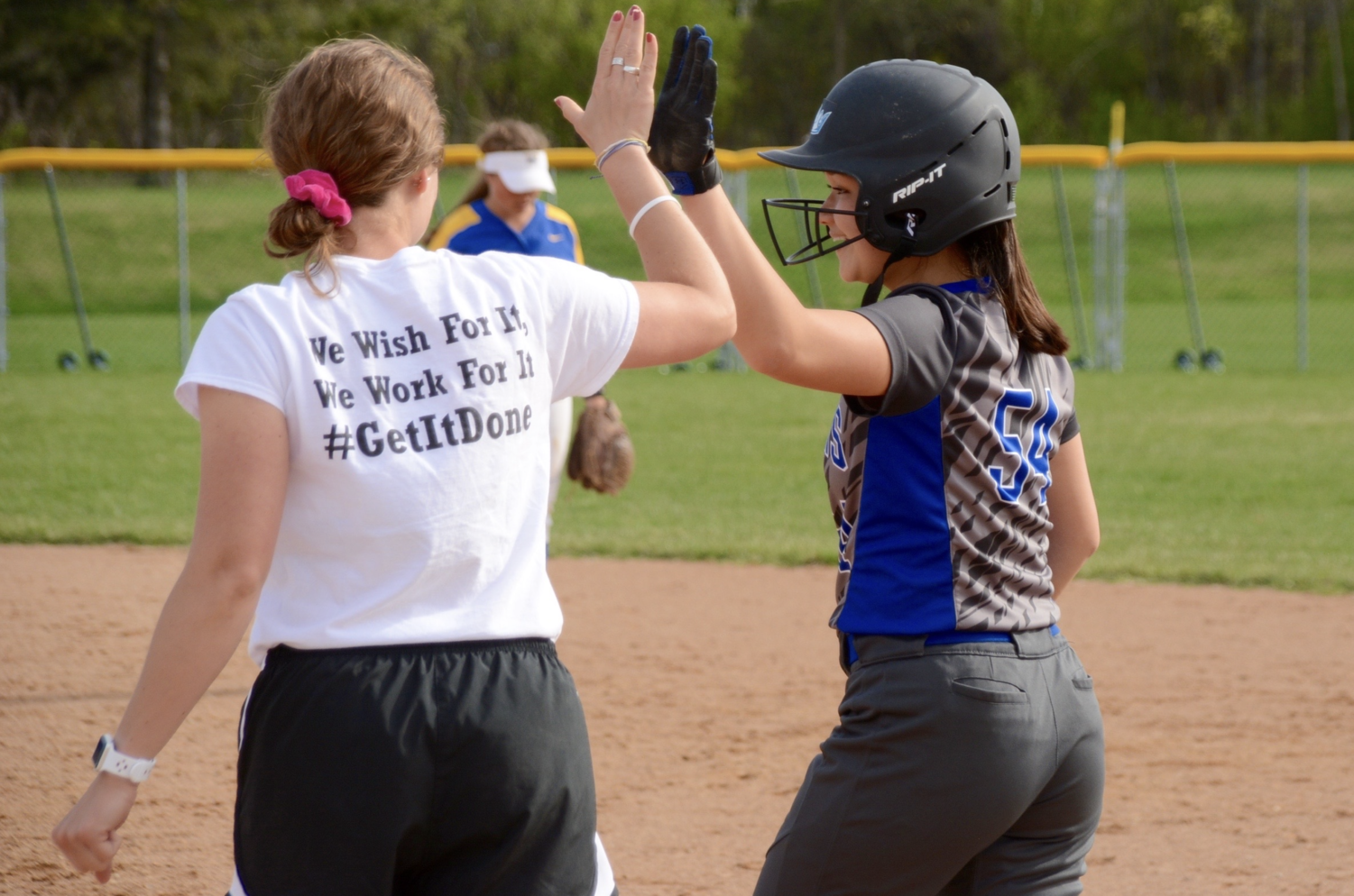 Annika Crouser, junior, talking with coach. Crouser plays second base.