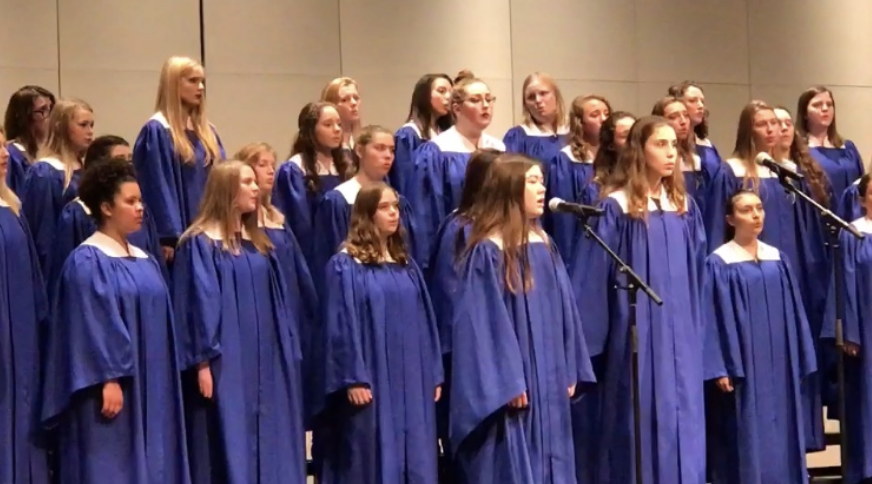 HHS+choir+and+Troutman+singing+at+a+concert.