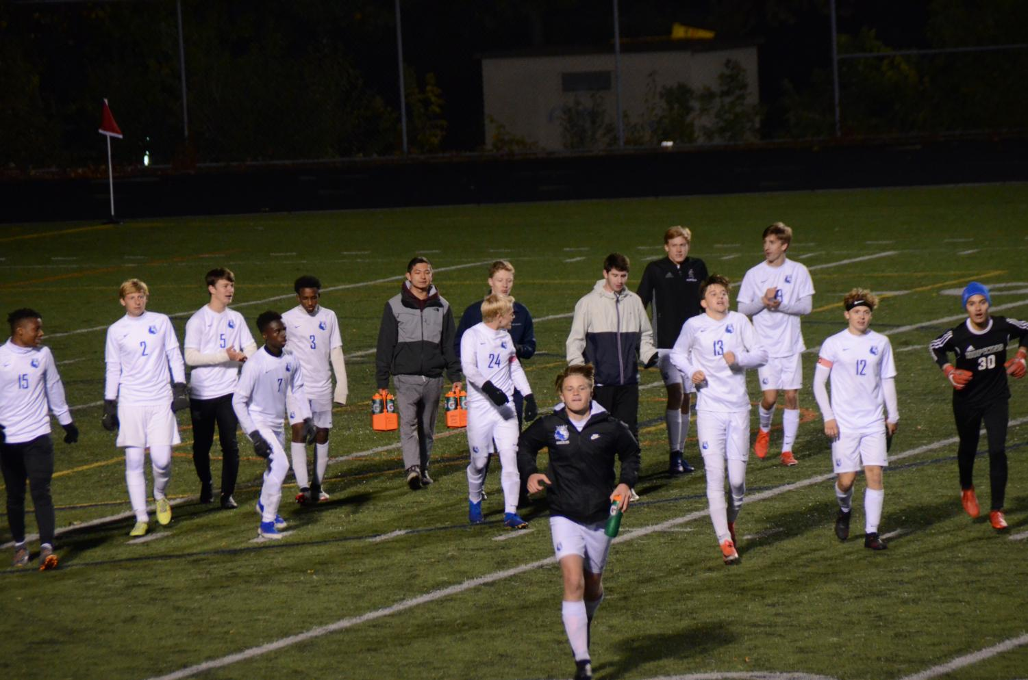 The Royals jog back to the bench after halftime. The Royals lost 1-0.