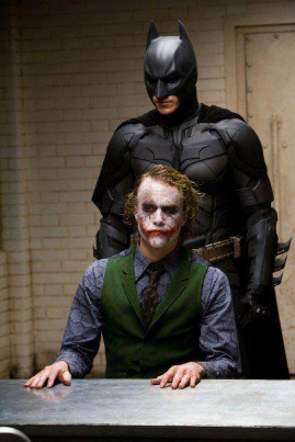Heath Ledger and Christian Bale as The Joker and Batman