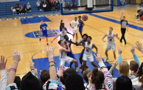 Boys basketball squares off against powerful Redhawks