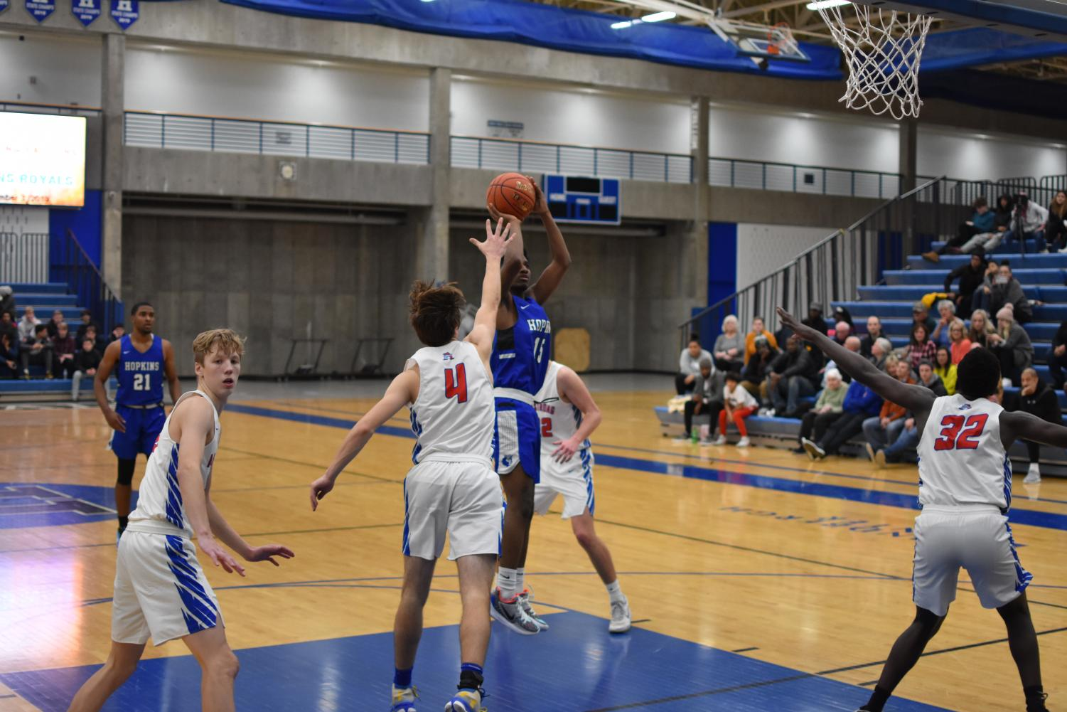 Cornell Richardson, senior, shoots the ball over and Armstrong player. Richardson and the Royals won this game 79-56.