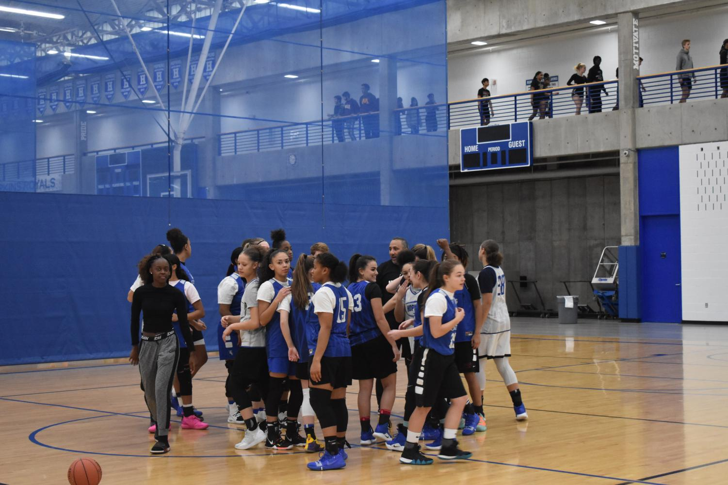 The girls basketball team breaks it down after a practice. The squad is currently ranked fifth in the nation, according to MaxPreps