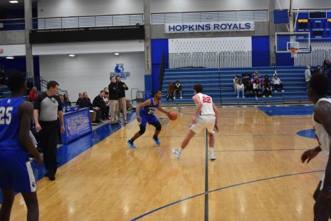 Andre Gray, junior, performs a crossover in a game against Armstrong. Gray and the Royals have a current record of nine wins and three losses