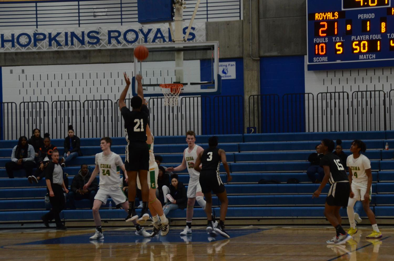 Andre Gray, junior, attempts a three pointer in a game against Edina. Gray and the Royals are currently ranked fifth in state.