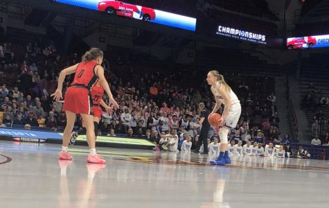 Paige Bueckers, senior, sizes up two Ponies defenders in the first half of the Royals 66-40 state semifinals victory over Stillwater. Bueckers finished the game with 15 points, 10 rebounds and seven assists