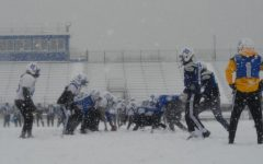 Football continues to practice despite severe weather