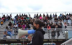 A North Junior High student holds the megaphone while speaking to hundreds of HHS and fellow NJH students.